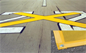 """Picture of 8ft x 60ft Temporary Runway """"X"""" YELLOW Closure Marker w/ 6"""" BLACK Border"""